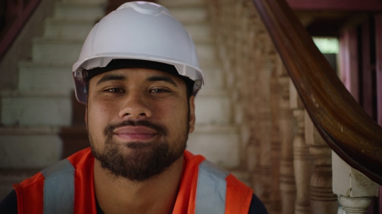 Portrait of builder on site with smile