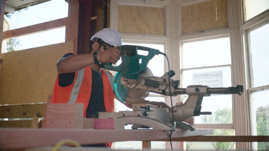 Builders operates circular saw