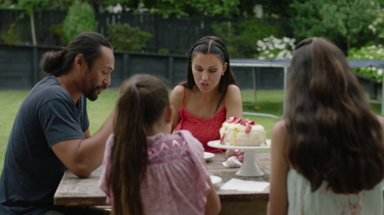 Family eating pavlova - stock video