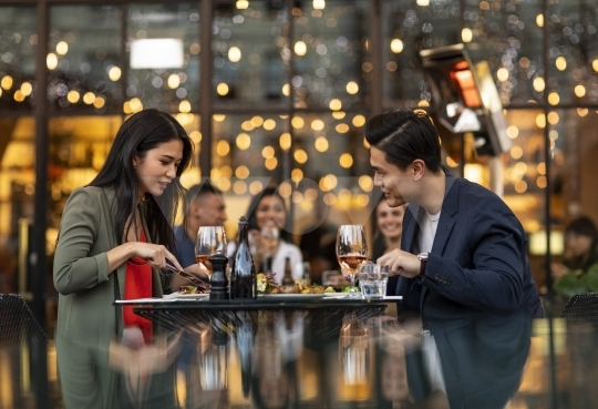 Dinner date at restaurant - stock photo