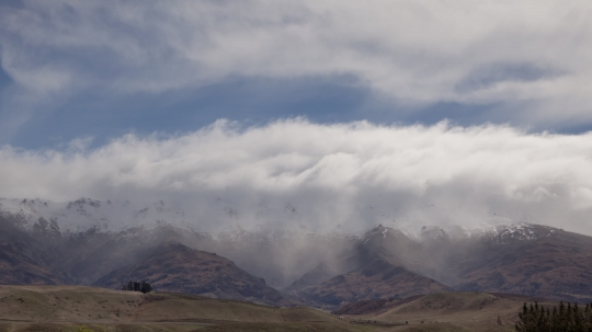 Snow falls on mountain range